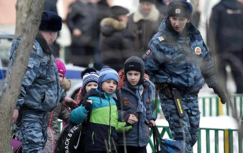 Police evacuate children from School No. 263 in Moscow on Monday.