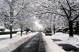 This is a picture of a street in Pittsburgh covered in the first snow fall of the year!